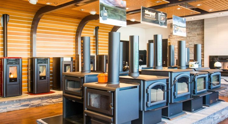 A warm showroom showing fires, pellet fires, log burners, heat pumps and heaters